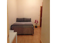 099T - BARONS COURT-WEST KENSINGTON, DOUBLE MODERN STUDIO FLAT,FURNISHED, BILLS INCLUDED - £250 WEEK