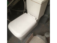 new modern square white toilet, complete with soft close lid