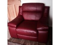 Leekes Red leather three seater sofa and arm chair in like new condition. Low price for quick sale