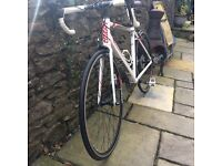 Giant defy road bike, white with red trim, slight scratch as in pics but in shop condition.
