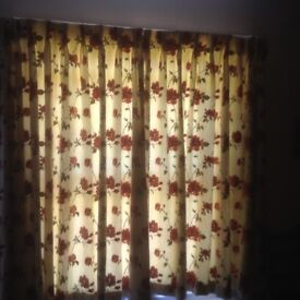 Lovely raised stitch floral cream curtains.