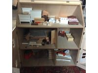 Dolls House with Furniture in used condition.