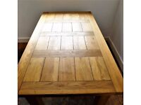 Rustic, solid oak table and four chairs in good condition