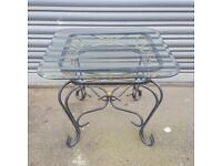 Coffee Table on Decorative Wrought Iron Base.