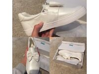 White shimmer bow pumps.