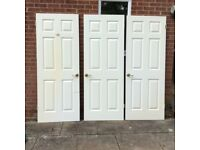 Three White Internal Heavy Solid Wood Quality Doors with Gold Colour Handles and Hinges.