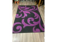 Purple and black rug