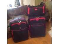 Two suitcases, large and medium plus hand luggage bad