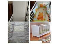 White wood baby cot, mattress, 2 duvets and cot bumper.