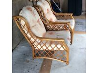 A pair of high backed conservatory chairs in excellent condition