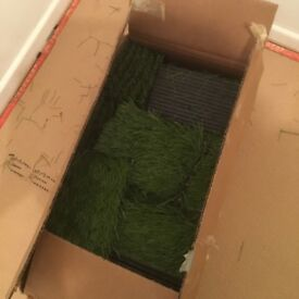 Box of artificial grass