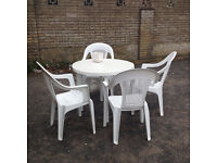 Garden table and 4 plastic chairs in good condition