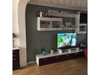 Tv stand and wall cabinets can deliver