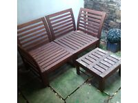 a set of garden or patio wooden table and chairs