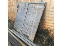 3 wooden posts , 1 fence panel