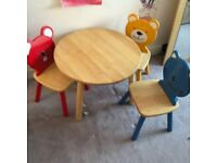 John Lewis round solid wood table with 3 brightly coloured character chairs . Normal price £149