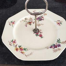 Antique cake plate with birds & silver handle.