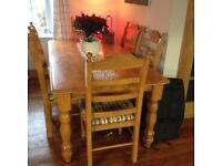 Farmhouse solid pine kitchen table and 6 chairs. .