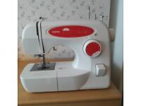 Brother sewing machine. Used but in great condition and recently serviced.