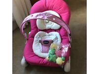 Pink Chicco Baby Bouncer/Seat in excellent condition with toy arch,toys and original box
