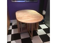 Rubber wood butterfly dining table.stores 4 chairs inside