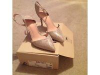 Gold sparkly next sandals