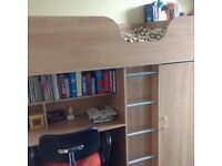 Cabinbed with desk, drawers and wardrobe.