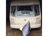 Two berth caravan with porch awning and full-size awning