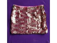 Bran new pink sequin mini skirt, size 6 and 12 available