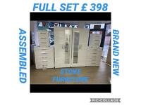 WHITE WARDROBE PACKAGES ON STRONG METAL RUNNERS AND ALL ASSEMBLED.