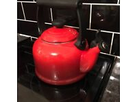 Red le creuset kettle