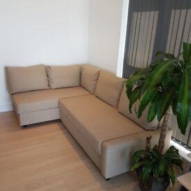 Corner L-shaped sofa bed Ikea Friheten with extra storage and extra pillows