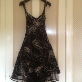 "Ladies Coctail dress by Debut, Black with cream embrodiery & underskirt of net. Size 16, Len 46""."