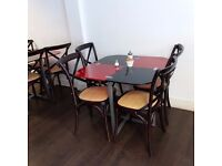cafe chairs with glass table