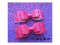 Two handmade bow hair clips.