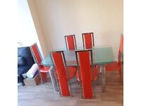 Beautiful Italian style dining table with 6 red chairs