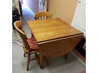 Good quality solid pine drop-leaf table and three chairs
