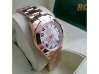 Mens - Rolex Daytona with all rose gold bracelet and silver face. All comes with Rolex bag and box