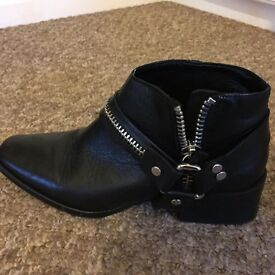 Black leather biker boots size 6. Bought from Zara.Excellent condition, worn twice as too big.