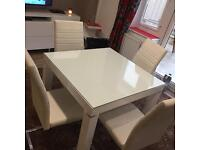 Table and chair harveys white high gloss