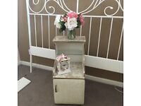 Vintage cabinet with clock and flowers