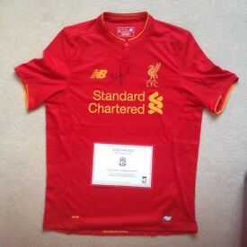 Liverpool FC signed shirt with certificate of authenticity.