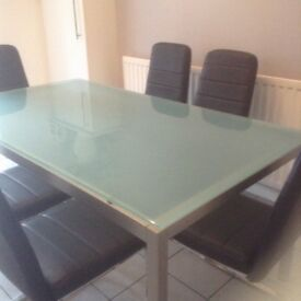 Glass dining table ,silver legs,seats 6