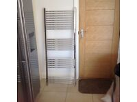 Chrome heated towel rail, excellent condition.