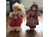 Two beautifully dressed Ornament Dolls on Stands.