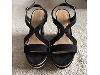 Black faux suede wedge heels from New Look.