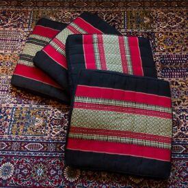 four Thai style cushions