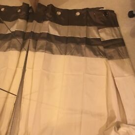 Lined curtain with brown striped pattern