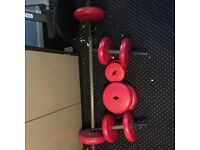 Over 50 kg of weights with two bars and dumbbells - weights of various sizes.