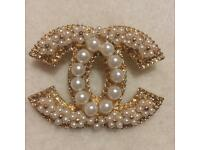 Chanel brooch as seen on Chanel in gold